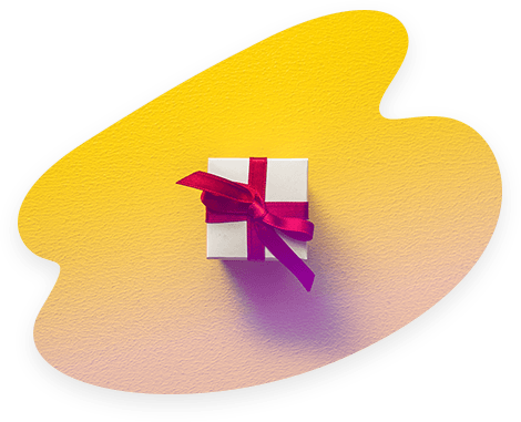 Un petit paquet cadeau avec un ruban rouge posé sur un support jaune